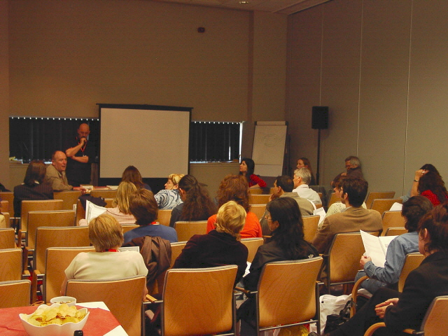 Gary Motteram (seated, middle, front) talking about the June 2006 event in Beijing